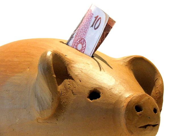 peníze v pokladničce
