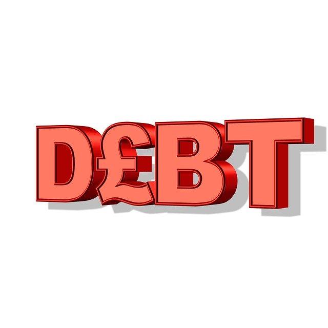 červený nápis debt